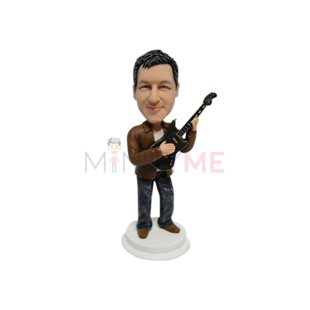 bobblehead of man and guitar
