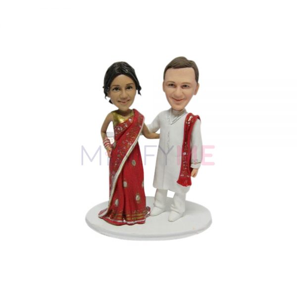 a wedding couple bobblehead